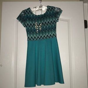 New,teal dress with a beautiful white necklace.